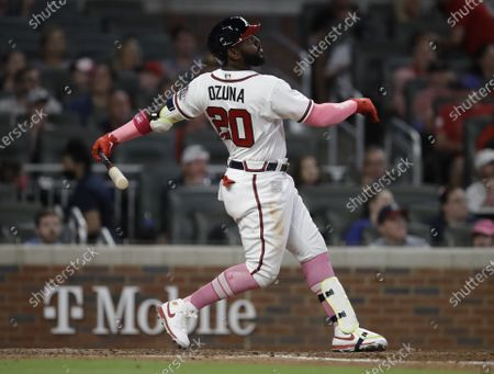 Atlanta Braves' Marcell Ozuna swings against the Philadelphia Phillies during a baseball game, in Atlanta