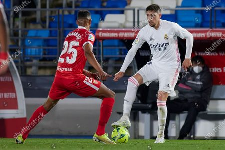 "Fede Valverde (Real Madrid CF) and ""Fernando"" Francisco Reges (Sevilla FC) are seen in action during the La Liga football match round 35 between Real Madrid and Sevilla FC at Valdebebas stadium in Madrid. (Final scores; Real Madrid 2:2 Sevilla FC)"