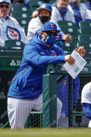 Stock Image of Chicago Cubs manager David Ross looks on from dugout during the fourth inning of a baseball game against the Pittsburgh Pirates, in Chicago