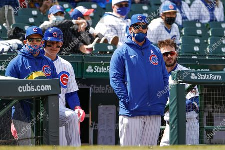 Chicago Cubs manager David Ross, second right, looks on from dugout during the fifth inning of a baseball game against the Pittsburgh Pirates, in Chicago