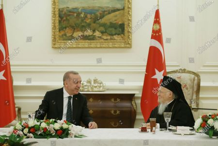 Turkey's President Recep Tayyip Erdogan, left, talks with Ecumenical Patriarch Bartholomew I, the spiritual leader of the world's Orthodox Christians, during a traditional Iftar dinner breaking the fast during the Muslim holy month of Ramadan, with religions leaders in Ankara, Turkey, . Iftar is the meal eaten by Muslims after sunset during Ramadan, the Islamic period of fasting when they cannot eat or drink during sunlight hours
