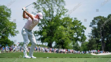Rory McIlroy tees off on the fourth hole during the fourth round of the Wells Fargo Championship golf tournament at Quail Hollow, in Charlotte, N.C