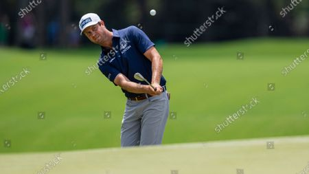 Harris English chips the ball on the ninth hole during the fourth round of the Wells Fargo Championship golf tournament at Quail Hollow, in Charlotte, N.C