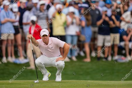 Rory McIlroy lines up a putt on the 18th hole during the fourth round of the Wells Fargo Championship golf tournament at Quail Hollow, in Charlotte, N.C