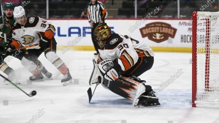Anaheim Ducks goalie Ryan Miller in acton against the Minnesota Wild during the first period of an NHL hockey game, in St. Paul, Minn. The Wild won 4-3 in overtime