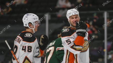 Anaheim Ducks center Isac Lundestrom, left, and center Ryan Getzlaf talk during a break in action against the Minnesota Wild during the first period of an NHL hockey game, in St. Paul, Minn. The Wild won 4-3 in overtime