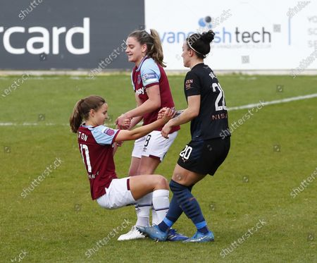 Anouk Denton of West Ham United WFC ( on Loan from Arsenal) gets a helping hand from Lucy Bronze of Manchester City WFC   during  Barclays FA Women's Super League  match between West Ham United Women and Manchester City  at The Chigwell Construction Stadium  on 25th April  , 2021 in Dagenham, England