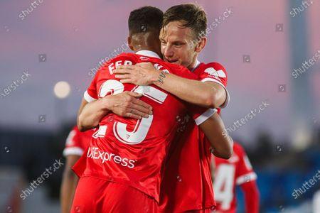 Fernando Francisco Reges of Sevilla celebrates a goal with Ivan Rakitic