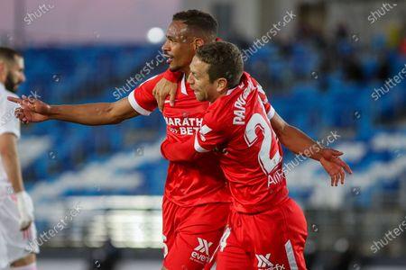 Stock Image of Fernando Francisco Reges of Sevilla celebrates a goal with Papu Gomez