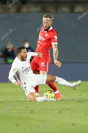 (210510) - MADRID, May 10, 2021 (Xinhua) - Real Madrid's Eden Hazard (L) lives with Sevilla's Nemanja Gudelj during a Spanish league football match between Real Madrid and Sevilla CF in Madrid, Spain, on May 9, 2021.