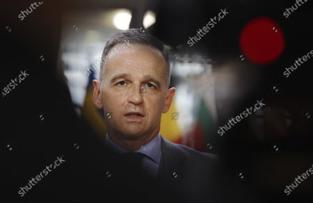 German Foreign Minister Heiko Maas speaks with the media as he arrives for a meeting of EU foreign ministers at the European Council building in Brussels, . EU Foreign Affairs Ministers meet in Brussels to discuss current affairs, tensions with Russia, the Western Balkans, transatlantic relations and Belarus