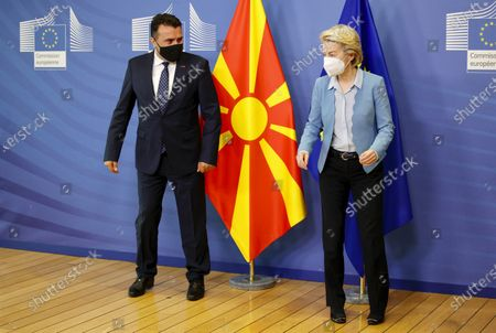 European Commission President Ursula von der Leyen, right, walks with North Macedonia's Prime Minister Zoran Zaev prior to an official greeting at EU headquarters in Brussels, Belgium, 10 May 2021.