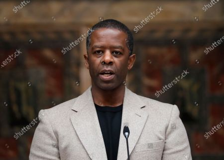 Stock Photo of British actor Adrian Lester speaks on stage at the official signing in ceremony for Sadiq Khan as the Mayor of London at Shakespeare's Globe Theatre in London, . Sadiq Khan was officially voted in for a second term as Mayor of London