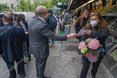 City Comptroller and mayoral candidate Scott Stringer handout flyers to locals during a campaign stop on the Upper West Side in front of Fairway Market on 74 and Broadway in New York City.   Voters will go to the polls for the Primary on June 22.