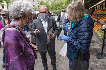 Stock Picture of City Comptroller and mayoral candidate Scott Stringer handout flyers to locals during a campaign stop on the Upper West Side in front of Fairway Market on 74 and Broadway in New York City.   Voters will go to the polls for the Primary on June 22.