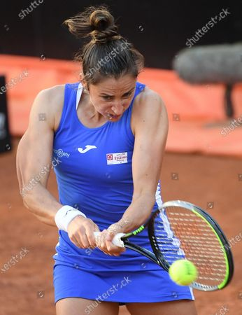 Stock Photo of Sara Sorribes Tormo of Spain in action against Camila Giorgi of Italy during their women's singles first round match at the Italian Open tennis tournament in Rome, Italy, 10 May 2021.
