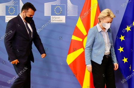 European Commission President Ursula von der Leyen, right, walks with North Macedonia's Prime Minister Zoran Zaev prior to an official greeting at EU headquarters in Brussels