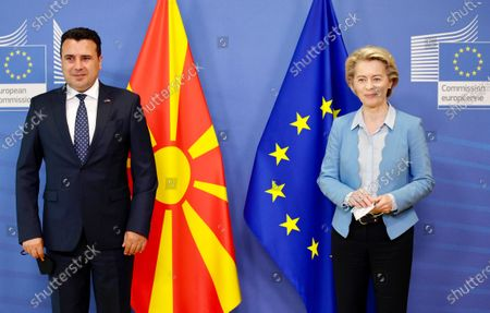 European Commission President Ursula von der Leyen, right, and North Macedonia's Prime Minister Zoran Zaev pose for photographers during an official greeting at EU headquarters in Brussels