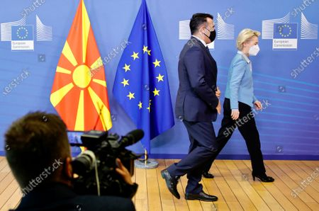 European Commission President Ursula von der Leyen, right, and North Macedonia's Prime Minister Zoran Zaev walk off the podium after an official greeting at EU headquarters in Brussels