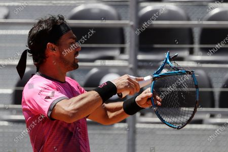 Italy's Fabio Fognini breaks his racket on the court during his match against Japan's Kei Nishikori at the Italian Open tennis tournament, in Rome