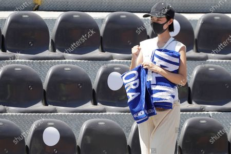 Mai Yamauchi, wife of Japan's Kei Nishikori, celebrates after her husband won a match against Italy's Fabio Fognini at the Italian Open tennis tournament, in Rome, . Nishikori won 6-3, 6-4