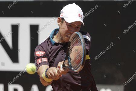 Japan's Kei Nishikori returns the ball to Italy's Fabio Fognini during their match at the Italian Open tennis tournament, in Rome
