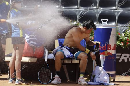Japan's Kei Nishikori changes his shirt during a match against Italy's Fabio Fognini at the Italian Open tennis tournament, in Rome