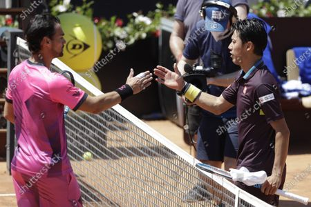 Japan's Kei Nishikori, right, and Italy's Fabio Fognini congratulate each other at the end of their match at the Italian Open tennis tournament, in Rome, . Nishikori won 6-3, 6-4