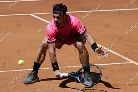 Italy's Fabio Fognini returns the ball to Japan's Kei Nishikori during their match at the Italian Open tennis tournament, in Rome