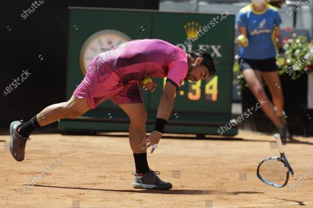 Italy's Fabio Fognini smashes his racket on the court during his match against Japan's Kei Nishikori at the Italian Open tennis tournament, in Rome