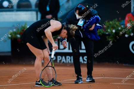 Simona Halep of Romania is forced to retire with injury from the second round of the 2021 Internazionali BNL d'Italia WTA 1000 tournament