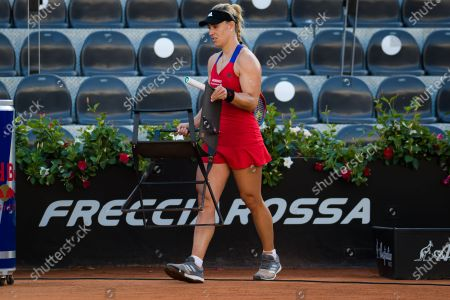 Angelique Kerber of Germany attends to Simona Halep after Halep is forced to retire with injury from the second round of the 2021 Internazionali BNL d'Italia WTA 1000 tournament