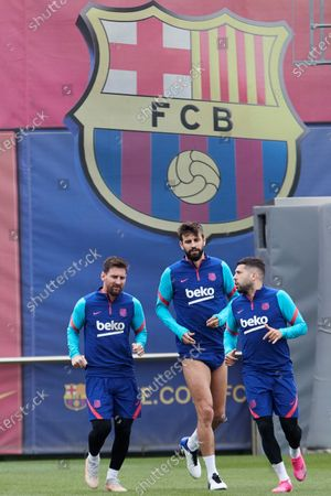 FC Barcelona's Argentinian striker Leo Messi (L), and Spaniards Gerard Pique (C) and Jordi Alba (R) attend the team's training session at the club's sport complex in Sant Joan Despi, in Barcelona, northeastern Spain, 10 May 2021. The team prepares its upcoming LaLiga game against Levante on 11 May.