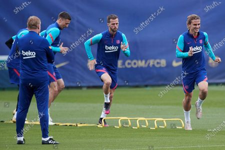 FC Barcelona's Antoine Griezmann (R), Miralem Pjanic (2R) and Lement Lenglet (3R) in action next to head coach Ronald Koeman (L) during the team's training session at the club's sport complex in Sant Joan Despi, in Barcelona, northeastern Spain, 10 May 2021. The team prepares its upcoming LaLiga game against Levante on 11 May.