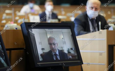 Stock Photo of Exiled Russian businessman and Russian opposition Mikhail Khodorkovsky, sits during a hearing by EU Parliament Committee on foreign interference in all democratic processes in the European Union, including Disinformation, in Brussels, Belgium, 10 May 2021.