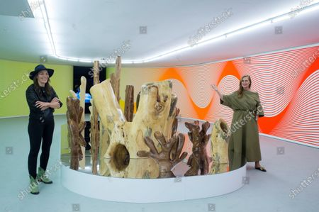 Stock Picture of Swiss artist Claudia Comte (L) and Swiss collector Francesca Thyssen-Bornemisza (R) pose with a piece of art that is part of Comte's installation 'After Nature' during its presentation during its presentation at Thyssen-Bornemisza Museum in Madrid, Spain, 10 May 2021. The installation, which will be on display at the museum from 11 May to 22 August, features a selection of sounds, mural paintings, and a series of sculptures addressing subjects like the relevance of the preservation of the oceans.