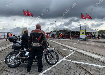 Motorcycle enthusiasts wait outside the Vaccine Village in Antwerp, Belgium, . Belgium's phased COVID-19 vaccination plan for is on track with the hopes of vaccinating as much of its population as possible by summer