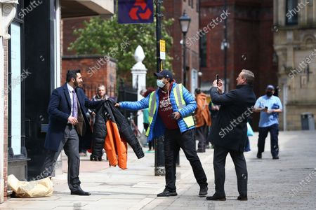Stock Photo of Michael Nardone, who plays D.I Neil McKinven in the BBC series Traces, takes photos of a fellow actor during filming in Stockport.