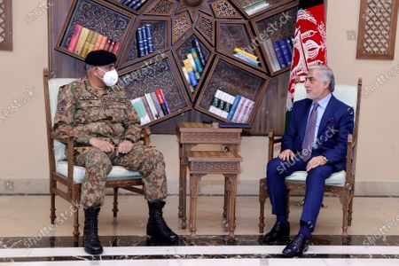 Abdullah Abdullah, Chairman of the High Council for National Reconciliation, right, meets with Pakistan's Army Chief of Staff Gen. Qamar Javed Bajwa, at the Sapidar Palace in Kabul, Afghanistan