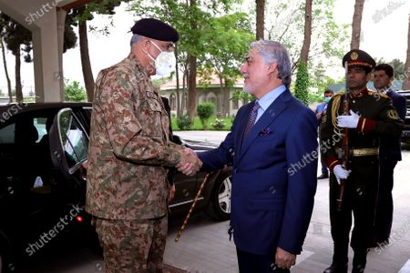 Stock Picture of Pakistan's Army Chief of Staff Gen. Qamar Javed Bajwa, left, shakes hands with Abdullah Abdullah, Chairman of the High Council for National Reconciliation, on his arrival to the Sapidar Palace in Kabul, Afghanistan