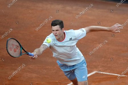 Hubert Hurkacz of Poland returns the ball to Lorenzo Musetti of Italy during their match at the Italian Open tennis tournament, in Rome
