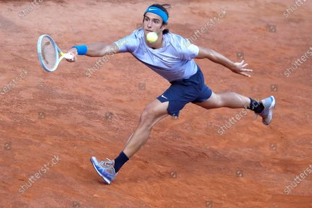 Lorenzo Musetti of Italy returns the ball to Hubert Hurkacz of Poland during their match at the Italian Open tennis tournament, in Rome