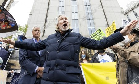 Stock Image of Musician Roger Waters (C) addresses supporters of environmental attorney Steven Donziger (L) outside of a US federal courthouse during a rally on the first day of a criminal contempt case against Donziger in New York, New York, USA, 10 May 2021. Donziger has been fighting legal battles brought against him in the United States by the oil company Chevron which came after a 2011 legal ruling in favor of Ecuadorian clients represented by Donziger in Ecuador that resulted in a 9.5 billion USD (7.9 billion Euro) judgement against Chevron for polluting. Donziger, who has been under house arrest for almost two years, and his legal team are claiming that the prosecution of the criminal contempt case against him is being handled in 'a vindictive and selective' manner and have claimed that the judge hearing the case is bias against him.