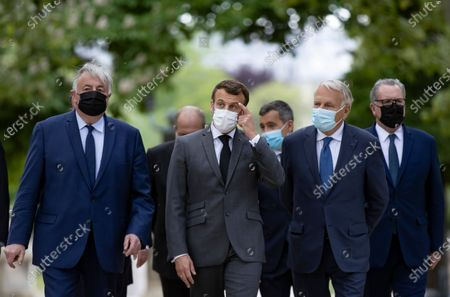 French President Emmanuel Macron (C) flanked by President of the Senate Gerard Larcher (L), French Minister of Interior Gerald Darmanin (3-R), former French Prime Minister Jean-Marc Ayrault (2-R) and the President of Parliament Richard Ferrand (R) arrive to attend  a ceremony at the Luxembourg Gardens to mark the abolition of slavery and to pay tribute to the victims of the slave trade, in Paris, France, 10 May 2021.