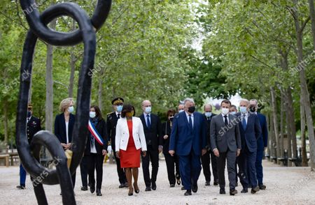 Stock Image of French President Emmanuel Macron (3-R) flanked by President of the Senate Gerard Larcher (5-R), former French Prime Minister Jean-Marc Ayrault (2-R), and President of Parliament Richard Ferrand (R), and cabinet ministers arrive to attend a ceremony at the Luxembourg Gardens to mark the abolition of slavery and to pay tribute to the victims of the slave trade, in Paris, France, 10 May 2021.