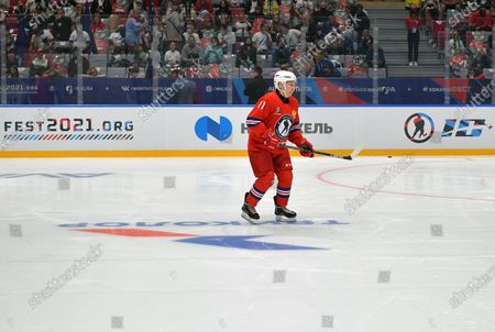 Russian President Vladimir Putin (R) takes part in a gala match with the participation of Russian hockey legends as part of the final stage of the X All-Russian Night Hockey League festival in the 'Bolshoi' Ice Palac in Sochi, Russia, 10 May 2021.