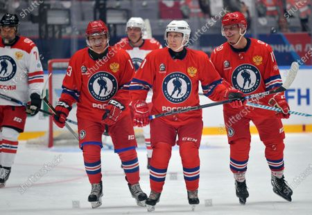 Russian President Vladimir Putin (C) and Russian Defence minister Sergey Shoygu (2-L) take part in a gala match with the participation of Russian hockey legends as part of the final stage of the X All-Russian Night Hockey League festival in the 'Bolshoi' Ice Palac in Sochi, Russia, 10 May 2021.