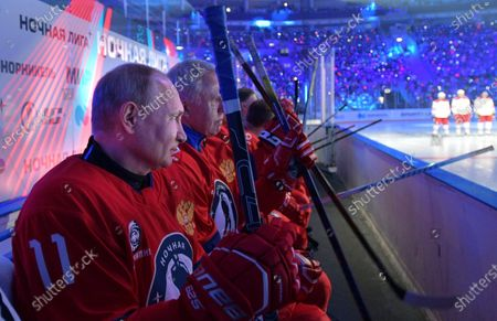Russian President Vladimir Putin (L) and Former hokey player and Night Hockey League Board Chairman Vyacheslav Fetisov (3-L) take part in a gala match with the participation of Russian hockey legends as part of the final stage of the X All-Russian Night Hockey League festival in the 'Bolshoi' Ice Palac in Sochi, Russia, 10 May 2021.