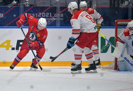 Russian President Vladimir Putin (L) takes part in a gala match with the participation of Russian hockey legends as part of the final stage of the X All-Russian Night Hockey League festival in the 'Bolshoi' Ice Palac in Sochi, Russia, 10 May 2021.