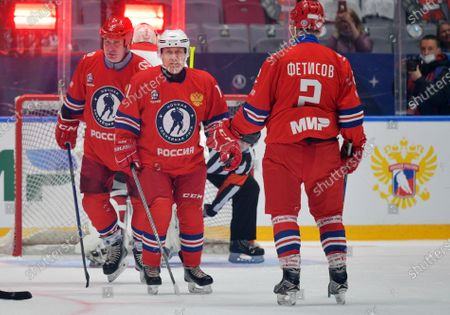 Russian President Vladimir Putin (C) and Former hokey player and Night Hockey League Board Chairman Vyacheslav Fetisov (R) take part in a gala match with the participation of Russian hockey legends as part of the final stage of the X All-Russian Night Hockey League festival in the 'Bolshoi' Ice Palac in Sochi, Russia, 10 May 2021.